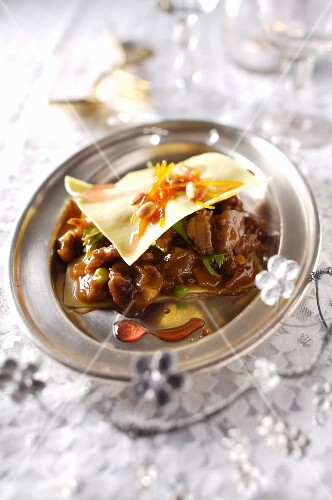 Beef stew, pine nut and confit orange ravioli