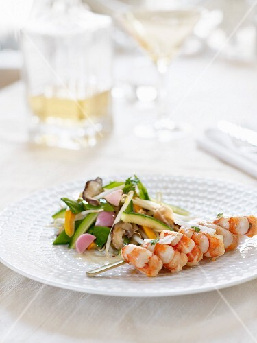 Gambas skewer, vegetable wok and coconut-citronella sauce