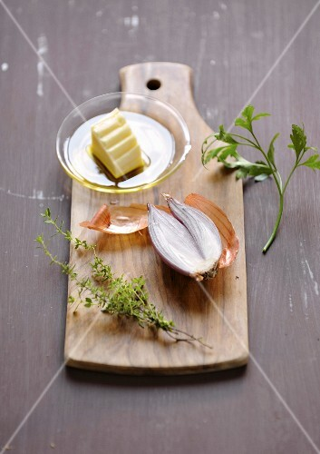 Still life with herbs,onion and butter