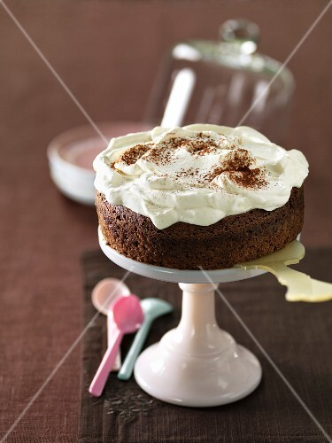 Chocolate cake garnished with whipped cream