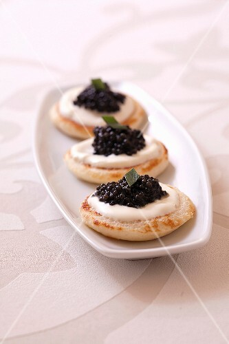 Blinis with tarragon cream and caviar