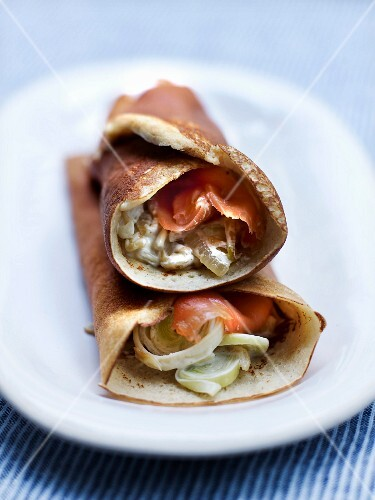 Quinoa galette cones garnished with leek fondue and salmon