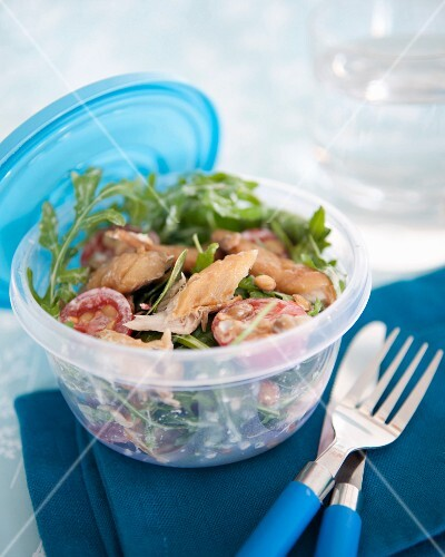Take-away rocket lettuce,tomato and smoked turkey salad in white dressing