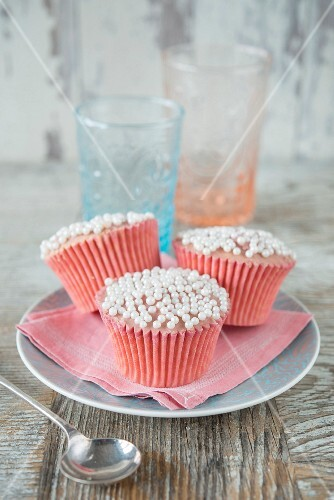 Cupcakes with rose frosting and sugar drops