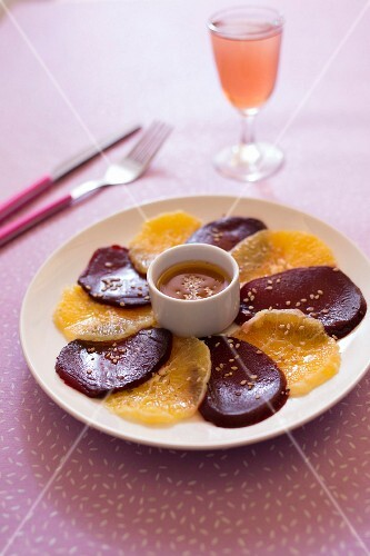 Beetroot and orange carpaccio with hazelnut oil and sesame seed vinaigrette