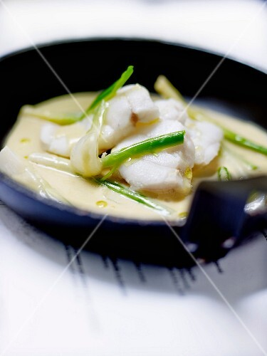 Bourride-style poached monkfish with spring onions and leeks