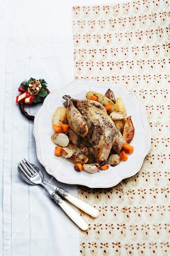Capon with garlic and winter vegetables