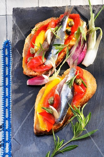 Raw anchovy,pepper and caper crostinis