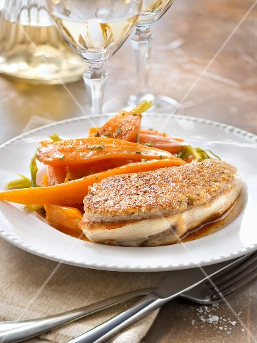 Chicken supreme in walnut crust and glazed carrots