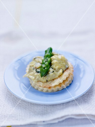 Scrambled eggs and green asparagus top on a parmesan shortbread canapé