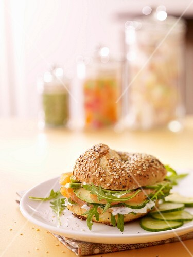 Salmon, avocado, rocket lettuce and cucumber bagel