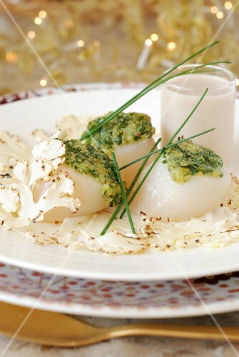 Scallops topped with mixed parmesan and chives,cream of brown shrimps,grilled cauliflower carpaccio