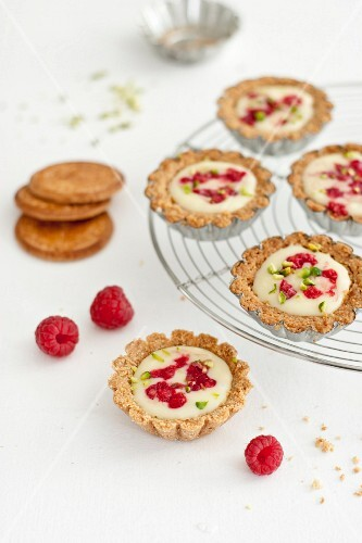 White chocolate,raspberry and crushed pistachio tartlets