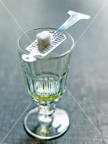 Glass of Absinthe and a sugarlump on an Absinthe spoon