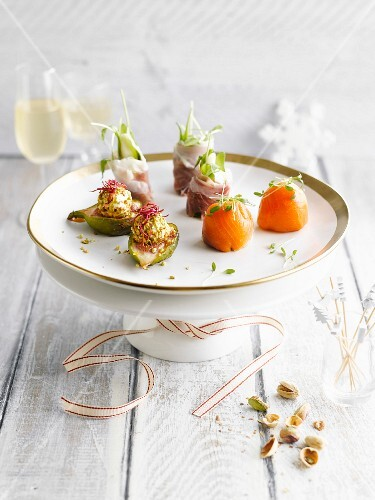 Various appetizers with salmon, figs and prosciutto
