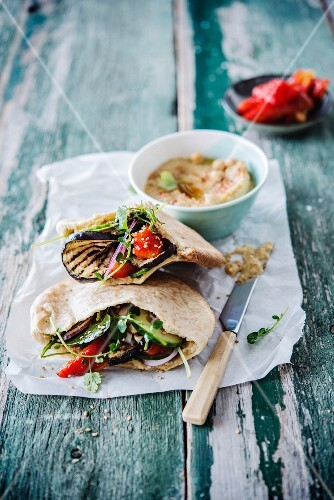 Pita bread with eggplant, red bell peppers and hummus