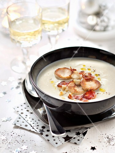 Cream of cauliflower soup with white poultry sausages, chorizo and macadamia nuts