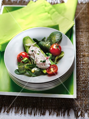 Cucumber with tuna stuffing,corn lettuce salad and cherry tomatoes with vinaigrette