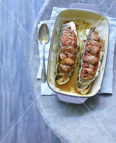 Bass fillets roasted with Parma ham and figs