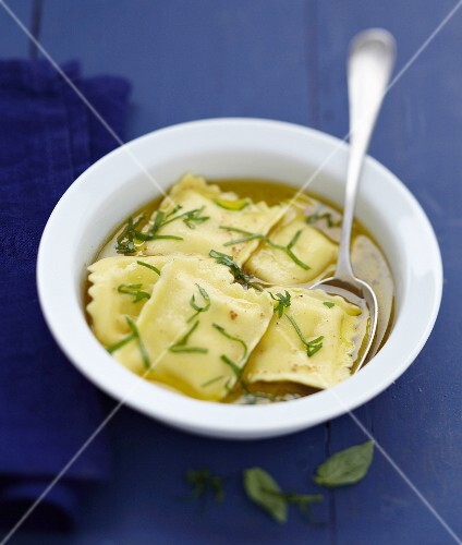 Salmon raviolis in basil broth