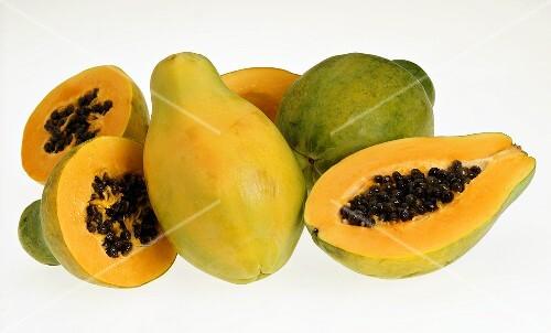 Papayas, whole and halved