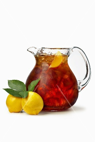 A Pitcher of Iced Tea with Lemons