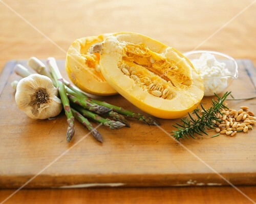 Still Life with Spaghetti Squash, Garlic, Asparagus, Rosemary and Pine Nuts on a Wooden Board