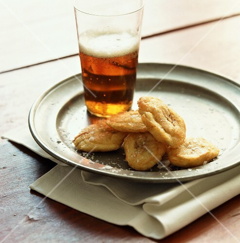 Banana chips and glass of beer