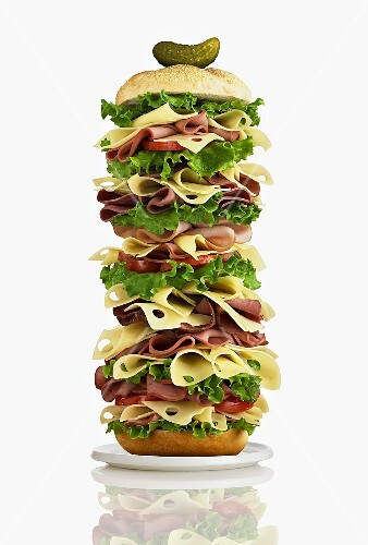 Giant club sandwich with ham, cheese and salad