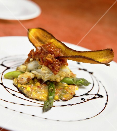 Crabmeat on sweetcorn sauce & green asparagus with banana chip