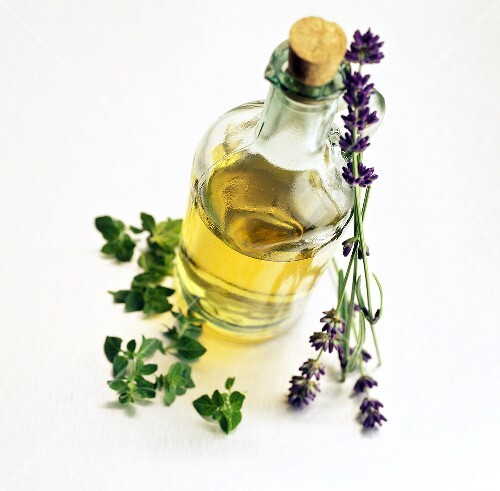 Bottle of Vinegar with Fresh Herbs