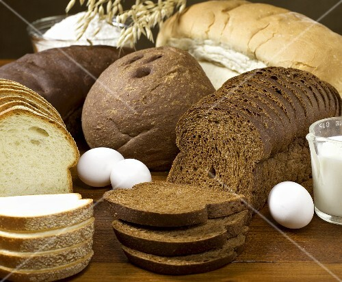 Assorted Loaves of Artisan Bread with Ingredients