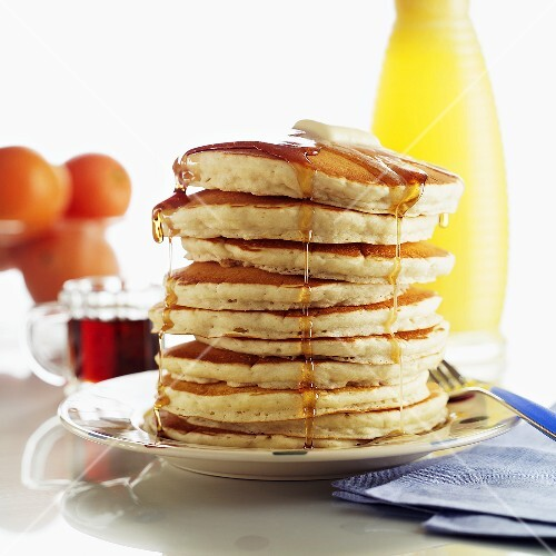 Tall Stack of Pancakes with Syrup and Butter