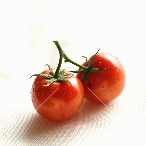 Two Red Tomatoes Connected at the Stem