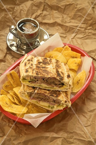 Cuban Sandwich Halved with Plantain Chips