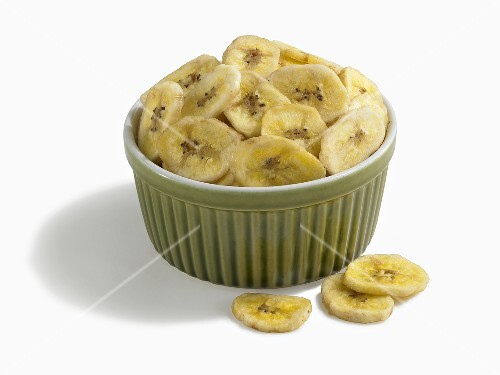 Bowl of Banana Chips on White