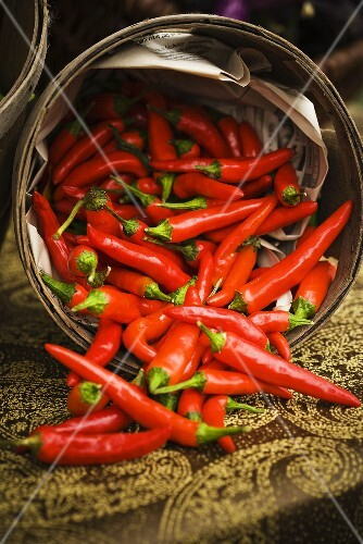 Red Chili Peppers Spilling From Basket