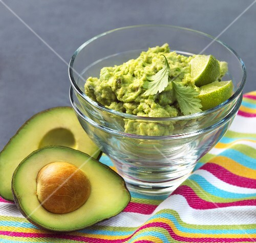 Classic Guacamole in a Glass Bowl; Fresh Avocados