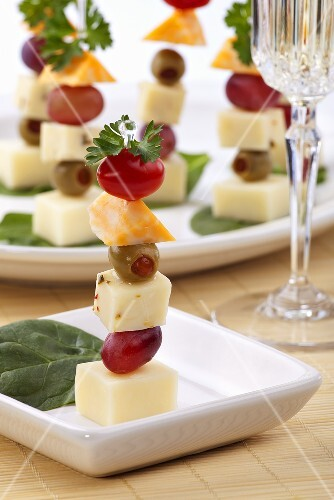 Three cheese canapes with olives cherry tomatoes and for Dictionary canape