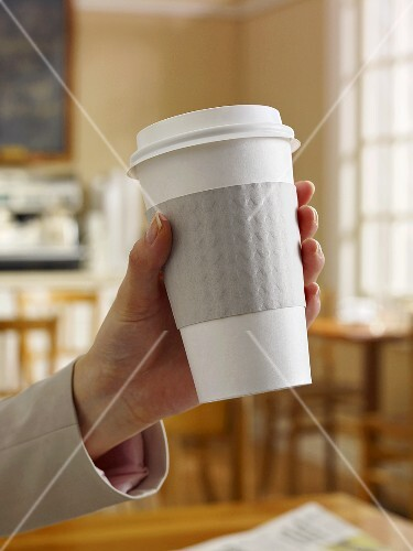To Go Coffee Cup in Womans Hand