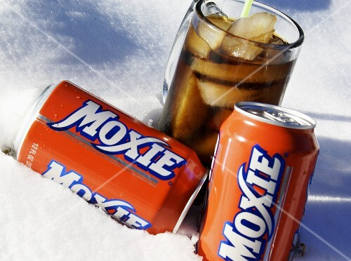 Glass and Two Cans of Moxie in the Snow