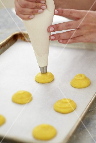 Piping Pastry Dough on Parchment Lined Baking Sheet
