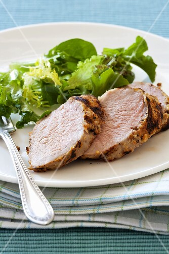 Slices of Spice Encrusted Pork Tenderloin with a Side Salad
