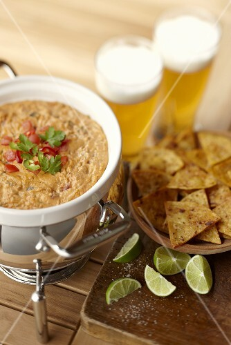 Salsa con queso dip with tortilla chips and beer (Mexico)