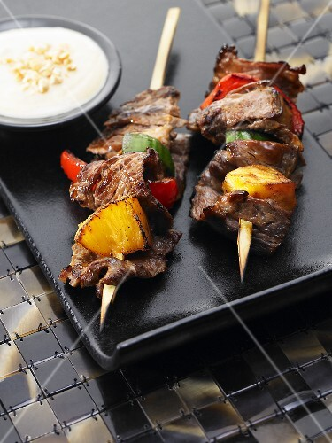 Indonesian beef skirt kebabs with pineapple, red peppers anda curry dip