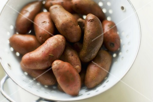 French Red Fingerling Potatoes on a Colander; From Above