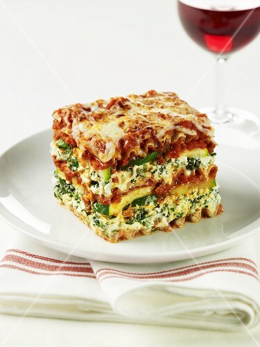 A slice of spinach and courgette lasagne on a plate