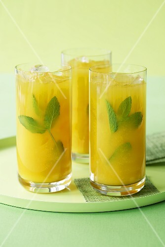 Three Tall Glasses of Mango Coolers with Mint; On Tray