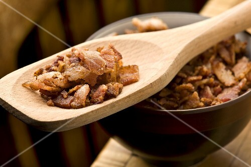 Bacon Bits in a Wooden Spoon; Bowl of Bacon Bits