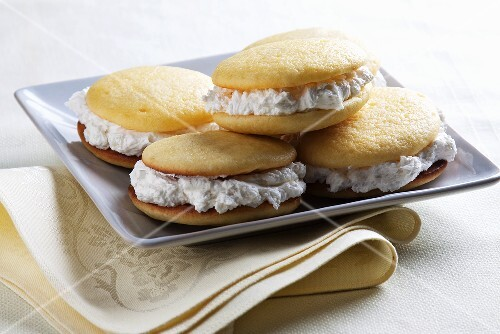 Lemon Whoopie Pies with Vanilla Cream on a Square Plate
